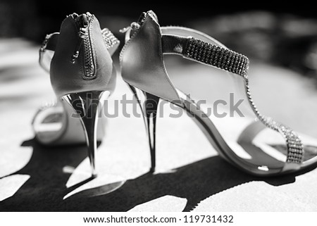 The bride's beautiful wedding day shoes - stock photo