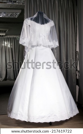 the bride's dress on a black background