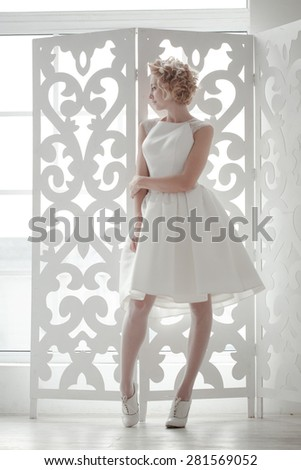 The bride standing on the window - stock photo
