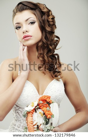 The bride with a wedding bouquet - stock photo