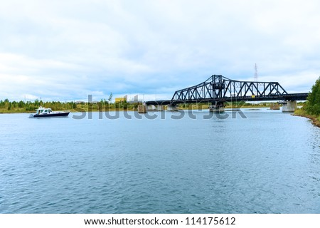 The bridge across a narrow channel separating Manitoulin Island from the much smaller Goat Island,Lake Huron, Georgian Bay Ontario Canada - stock photo