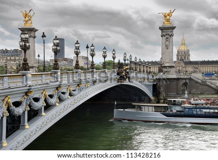 The bridge Alexander III across river Seine in Paris, France. - stock photo