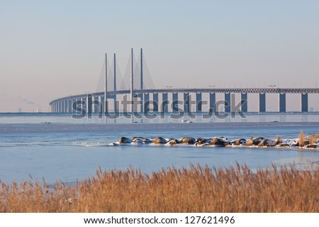 """The bridge between Denmark and Sweden. Here in shape of winter and from the Swedish side. Also recording location for the global Scandinavian TV-series """"The Bridge"""". - stock photo"""