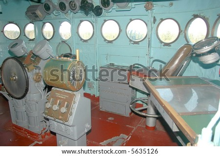 The bridge of a WWII battleship showing the captains chair. - stock photo