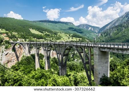 the bridge of Dzhurdzhevich over the Tara River Canyon. Montenegro - stock photo