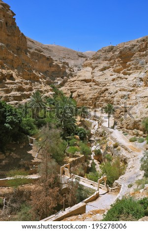 The bridge on a mountain road going to the temple - the Monastery of St. George the Victorious. Wadi Kelt near Jerusalem. - stock photo
