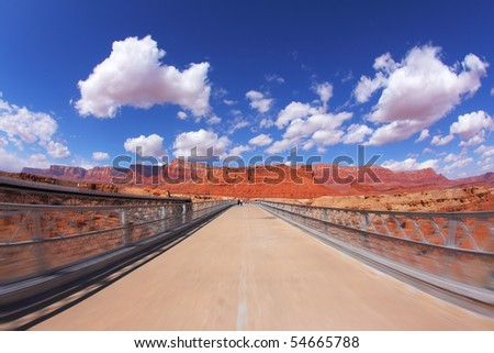 The bridge over the Colorado River and shining light clouds - stock photo