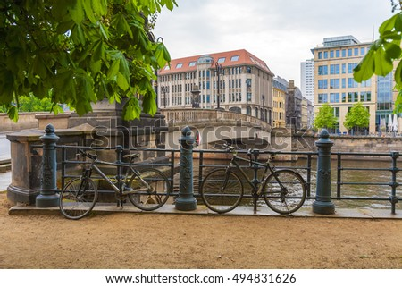 The bridge over the river Spree and a few bicycles chained to the railings of the promenade, Berlin, Germany