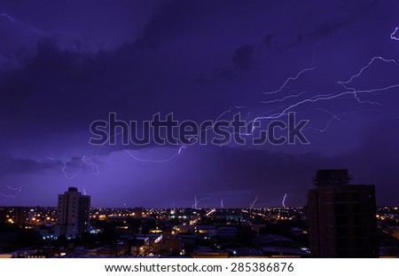The bright blizzards in the night sky above the city
