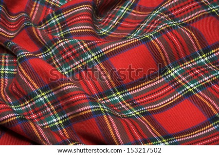 The bright scottish checked fabric. - stock photo