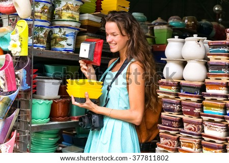 the bright woman chooses ware in shop, bright ware, the happy woman, shopping