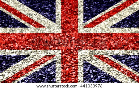 The British flag on a background of pebbles in water