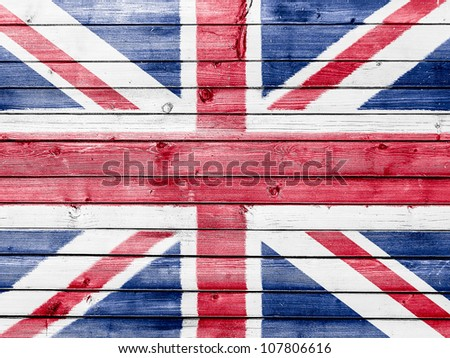 The British flag painted on wooden fence - stock photo