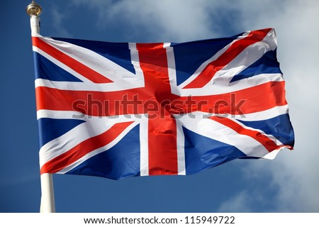 The British flag waving in the wind - stock photo