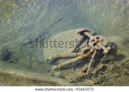 The broken bicycle in the river - stock photo