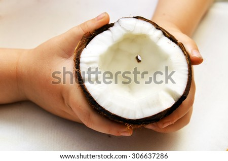 the broken fresh coconut on a white background