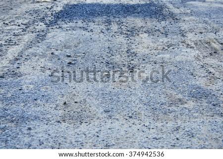 The broken road some area already repair. - stock photo