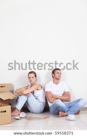 The broken saucer on the background of a row of couples - stock photo