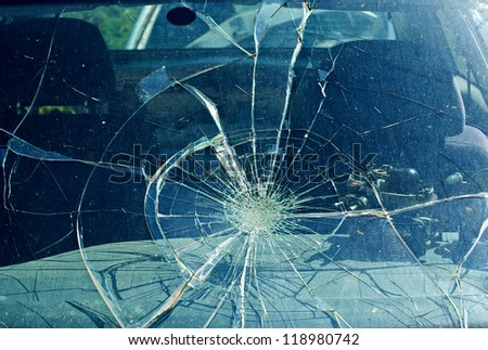the broken windshield in car accident - stock photo