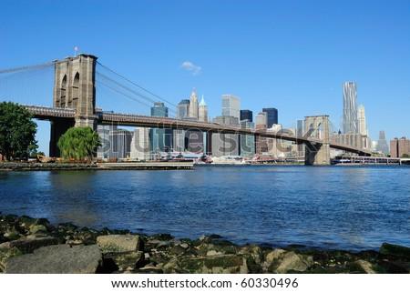 The Brooklyn Bridge and Downtown Manhattan in New York City. - stock photo