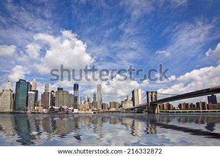 The Brooklyn bridge and Manhattan skyline, New York City, USA - stock photo