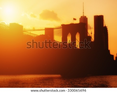 The  Brooklyn Bridge and the downtown Manhattan skyline at sunset - stock photo