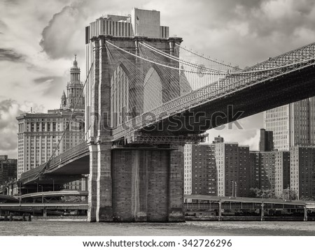 The Brooklyn Bridge and the lower Manhattan skyline in New York City - stock photo