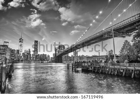 The Brooklyn Bridge Park, New York. Manhattan skyline at summer sunset. - stock photo