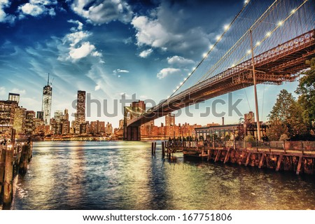 The Brooklyn Bridge Park, New York. Manhattan skyline at summer sunset. - stock photo
