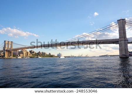 The Brooklyn Bridge spans across the East River on a late afternoon in September 2012. - stock photo