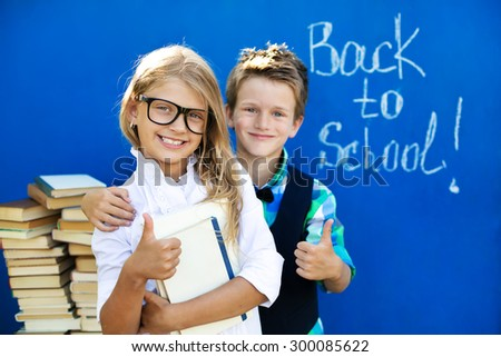 The brother and sister with the books are preparing to the new school year - stock photo