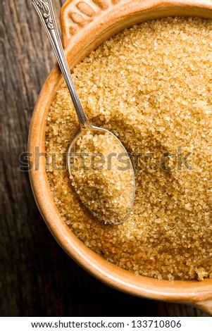 the brown sugar in silver spoon - stock photo