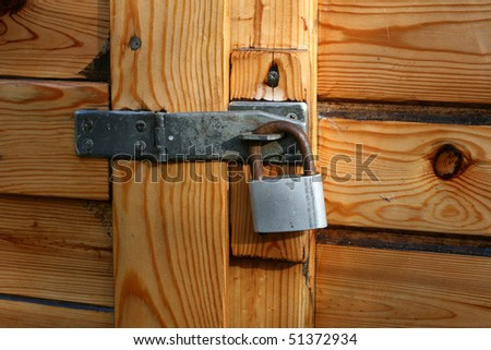 the brown wood texture and padlock - stock photo