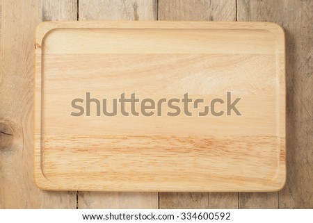 The brown wooden plate on a table. horizontal top view - stock photo