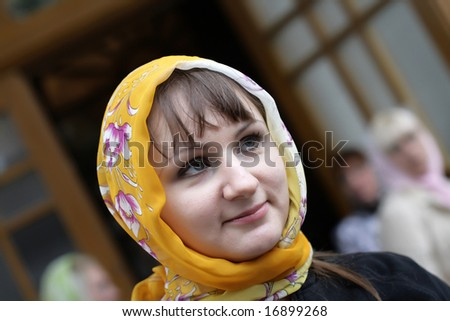 The brunette girl in yellow headscarf, outdoor - stock photo