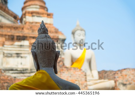 The Buddha status, sensitive focus at head of front status and blured background - stock photo