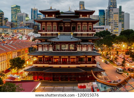 The Buddha Tooth Relic Temple in Singapore's Chinatown at sunset - stock photo