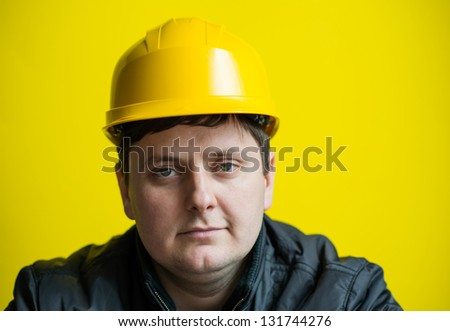 The builder in a helmet showing emotion
