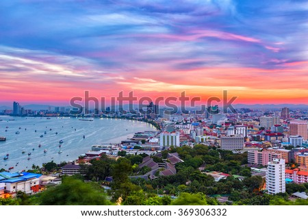 The building and skyscrapers in twilight time in Pattaya,Thailand. Pattaya city is famous about sea sport and night life entertainment. - stock photo