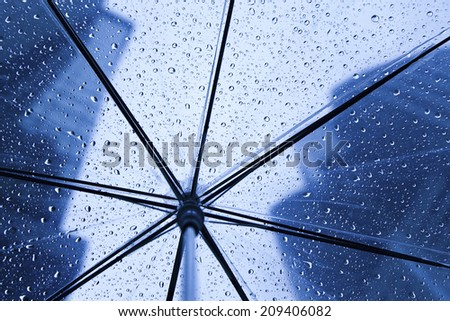 The Building Area In __Rain Visible From The Plastic Umbrella - stock photo