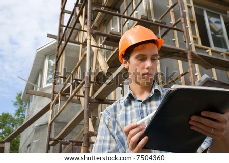 The building inspector on a working platform.