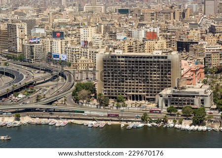 The building used by the National Democratic Party of the ousted president Mubarak remains burnt and abandoned serving as a reminder of the 2011 Egypt Revolution. Cairo, Egypt - April 26, 2014. - stock photo