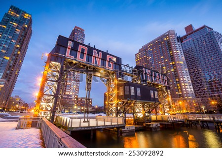 the buildings of long island in front of east river at twilight - stock photo