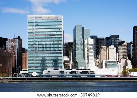 The buildings of the United Nations headquarters in Manhattan, New York City, on the waterside of the East River. - stock photo