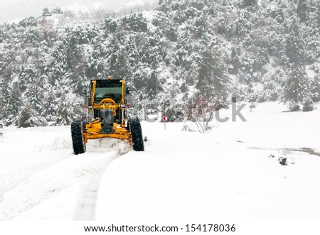 The bulldozer cleans snow on road r cleans snow on road