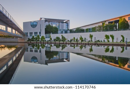 The Bundeskanzleramt (Kanzleramt) with panorama reflection, famous landmark in Berlin - Chancellery is the seat of the German federal government and the residence of the German Bundeskanzler - stock photo