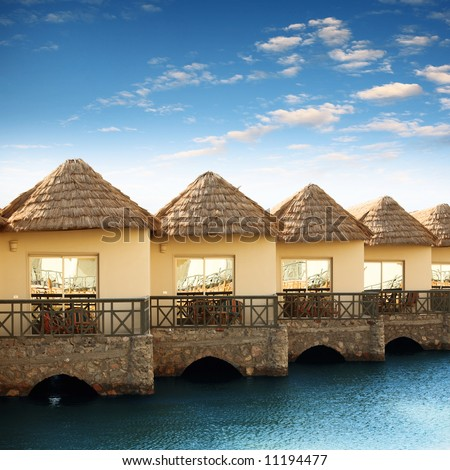 The bungalows are right on the water - stock photo
