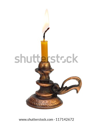 the burning candle in the ancient bronze candlestick isolated on white - stock photo