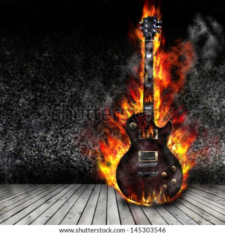 The burning guitar in the old room - stock photo