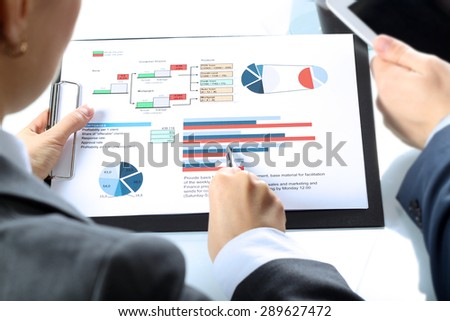 The Business colleagues working and analyzing financial figures - stock photo